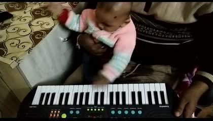 CUTE BABY PLAYING PIANO KEYBOARD